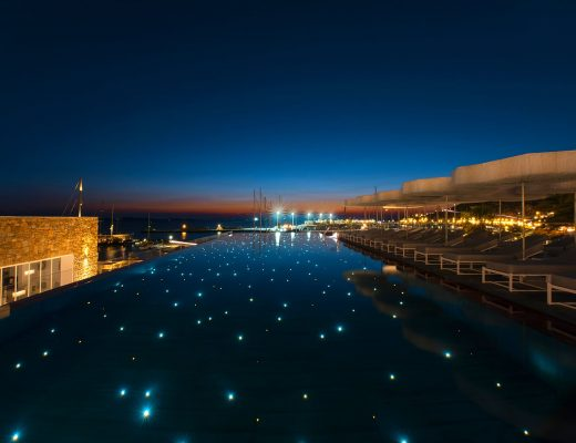 Dusk at the infinity swimming pool of Mykonos Riviera hotel & luxury villas in Mykonos Town.
