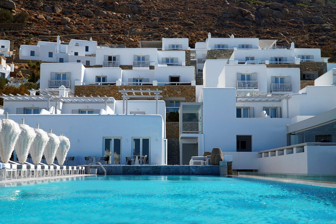 The facade of the luxury Mykonos Riviera hotel and spa overlooking the infinity swimming pool.