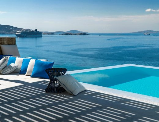 Pillows by the pool overlooking the sea in the Mykonos Riviera hotel and spa.